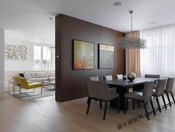 这是一间位于莫斯科市中心的LOFT公寓,设计师为了彰显出现代简约的个性,将金属、木质和玻璃三种材料合理地混搭在了一起,并打造出了这个个性鲜明的居住空间。    此外,深色木制的隔断墙将客厅与餐厅巧妙地进行了分割,从而让两个完全不同风格的区域得到最充分的发挥,金属圆环墙饰以及正方形的艺术挂画也大大提升了空间的美感。