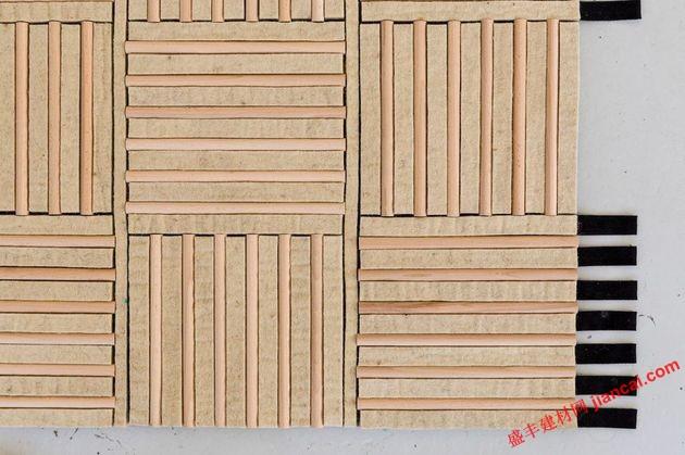 枫木材板条连接到羊毛垫子下,吸收声音,并添加额外的温暖.